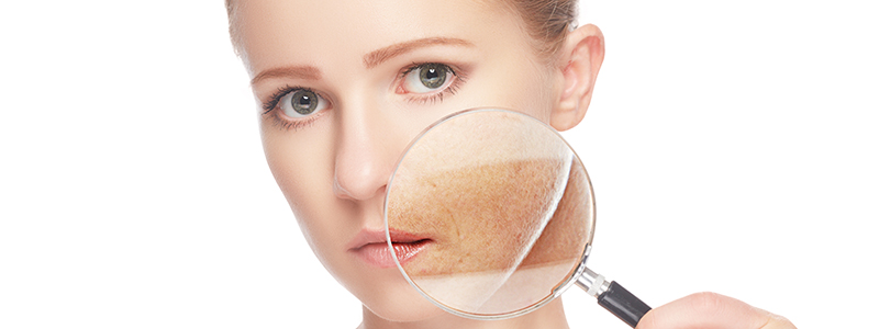concept skincare. Skin of beauty young woman with magnifier befo